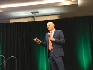 AJ Schneider speaking at a customer loyalty conference in 2019